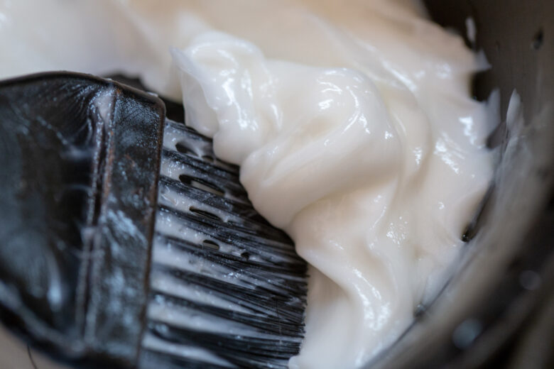 Background of Barber supplies, applying color cream at hair in salon.