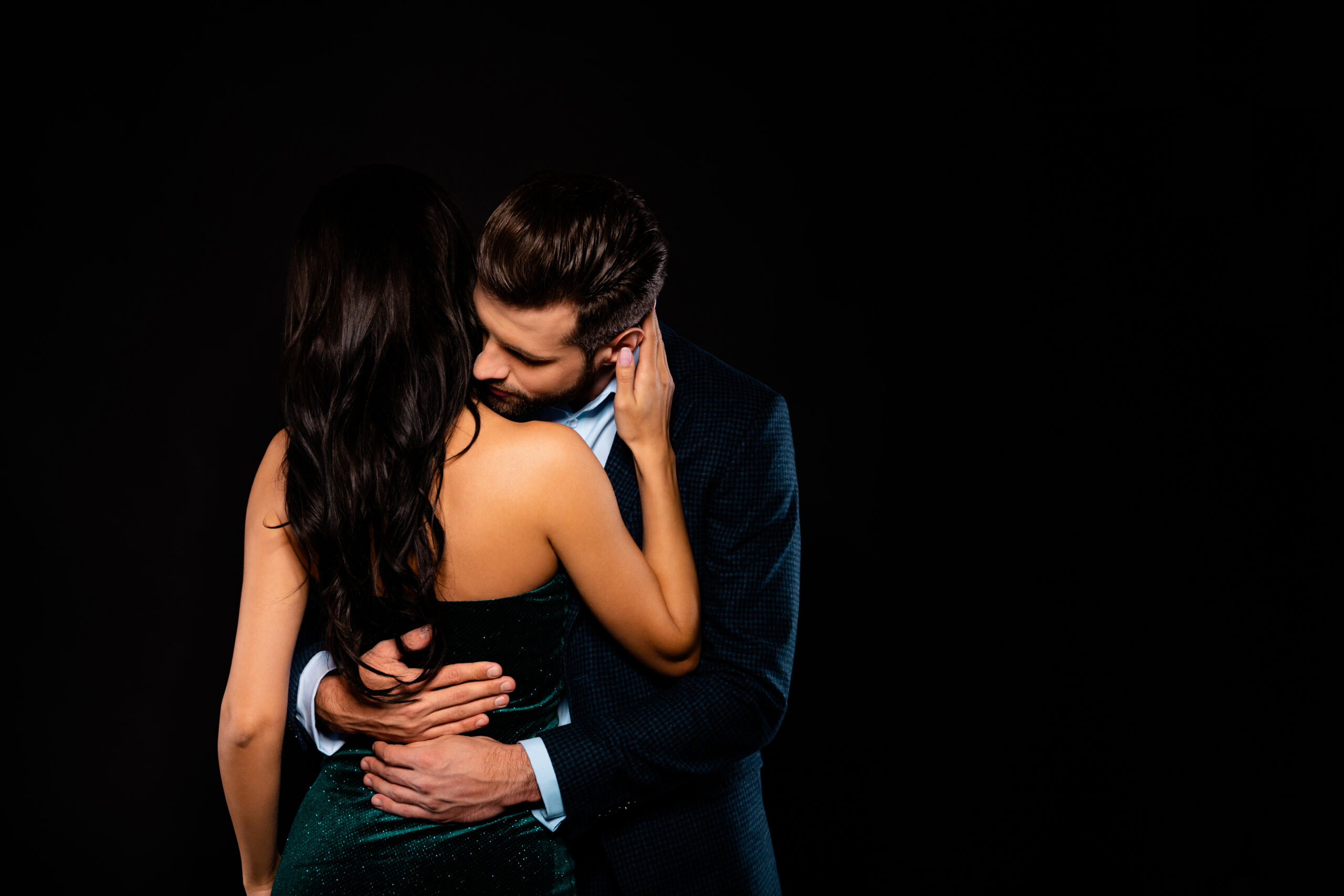 Close up back rear behind photo beautiful she her wife spine he him his husband mrs mr married spouse hands waist bend touch hold close wear costume jacket green dress isolated black background